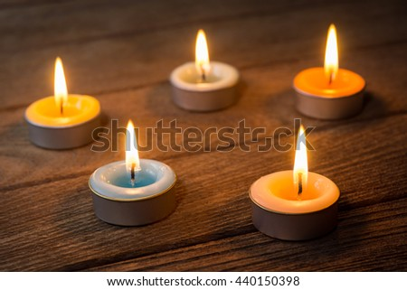various color and smell of burning spa candles on old wood