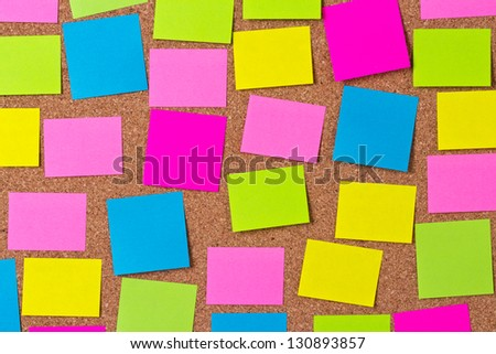 Various color note papers on cork bulletin board