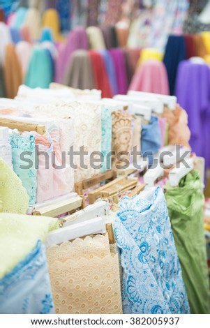 various color of fabric and textiles in shop for sale, business
