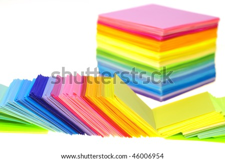 various color paper stack like a rainbow isolated on white. shallow deep of field