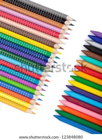 Various color pencils and markers. Isolated on white background - stock photo