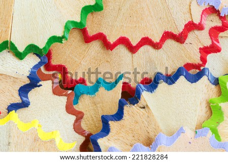 Various, colorful and highly detailed pencil shavings randomly laying around - stock photo
