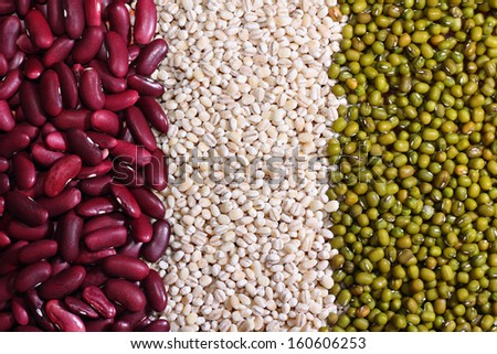 Various colorful beans and grains as background