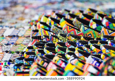Various colorful bracelets on sale at a street market vendor in Cape Town, South Africa - stock photo