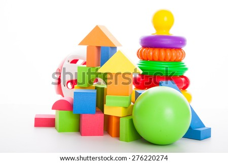 Various colorful kid's toys against the white background - stock photo