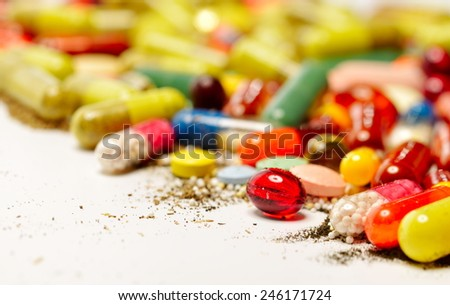 various colorful pills against white background - stock photo