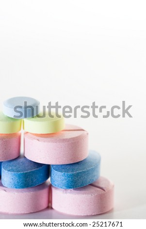 Various colorful pills on a white background.