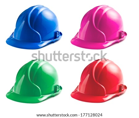 various colors of hard hats on white background - stock photo