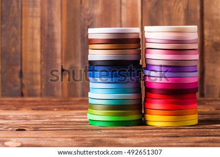 Various colors ribbon bobbins stand as a tower