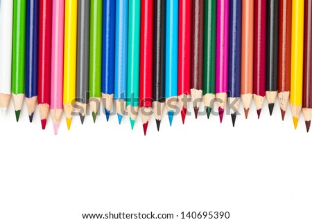 Various colours of pencil crayons against a white background. - stock photo