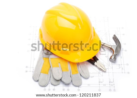 Various construction tools on blueprint