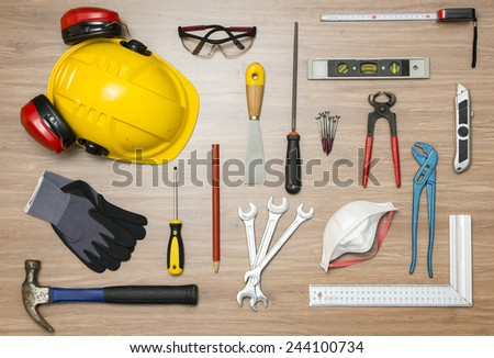 Various construction tools on floor - stock photo