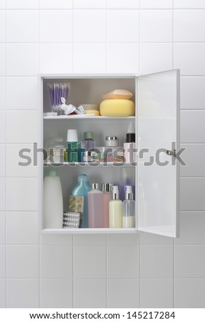 Various cosmetics and bath products in bathroom cabinet - stock photo