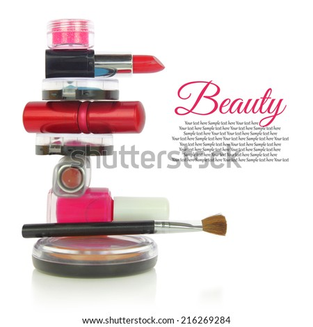 Various cosmetics in a row isolated on white - stock photo