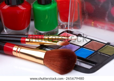 Various cosmetics isolated on a white background - stock photo