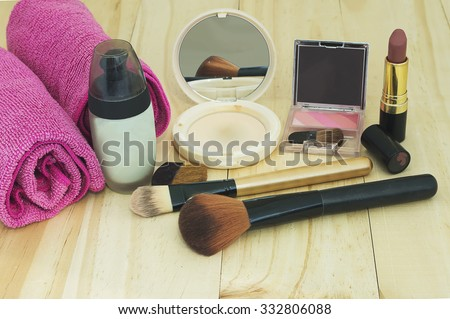 Various cosmetics on wooden background - stock photo