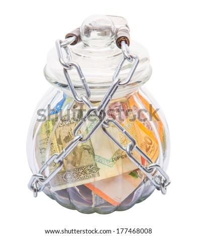 Various country bank notes in a glass cookie jar. Secure home banking concept. - stock photo