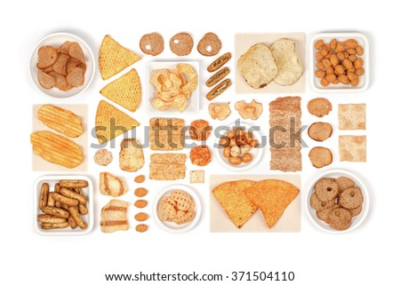 various crisps and snacks on white background above view