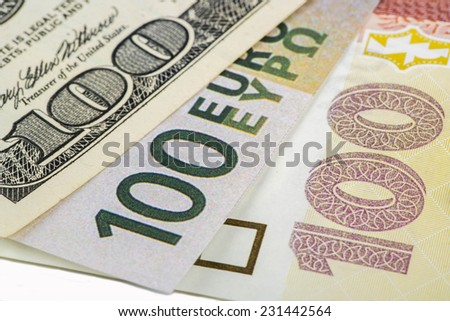 Various currencies in the denomination of 100 dollars, euros, the hryvnia. - stock photo