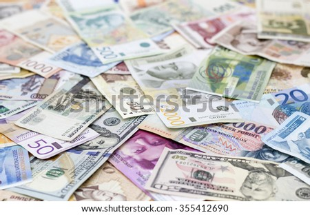 various currencies on the table - stock photo