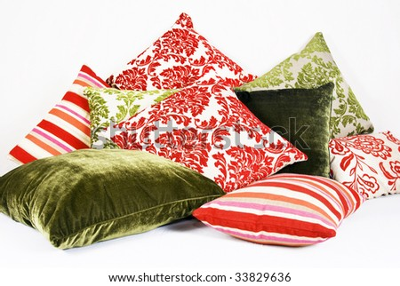 various cushions in different colors and patterns - stock photo