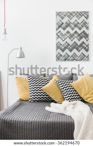Various cushions on the bed in cozy bedroom - stock photo