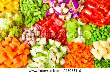 Various cut vegetables on wood - stock photo
