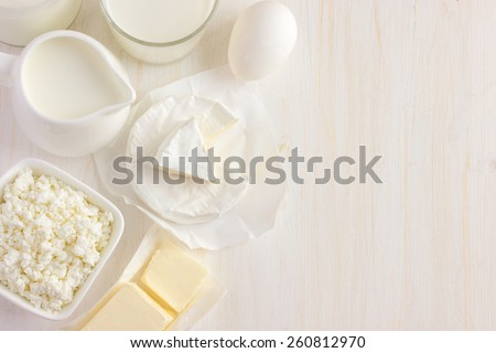 Various dairy products  on white background, top view, copy space - stock photo