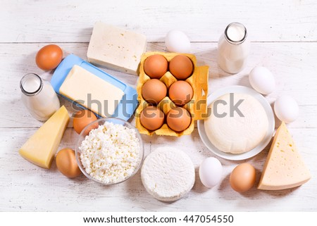 various dairy products on wooden table - stock photo