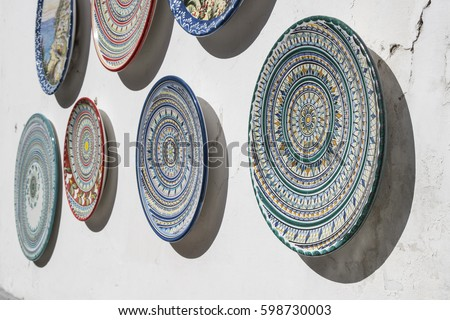 various decorated pottery dishes hung for sale outside a souvenir shop in vietri sul mare - Vietri Dishes
