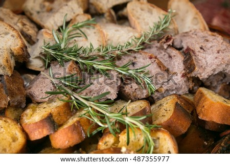 Various delicious types of sliced bread with rosemary dressing