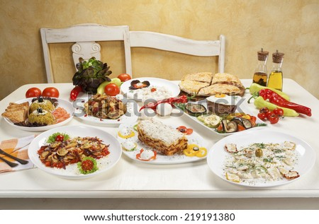 Various dishes served on the table. - stock photo