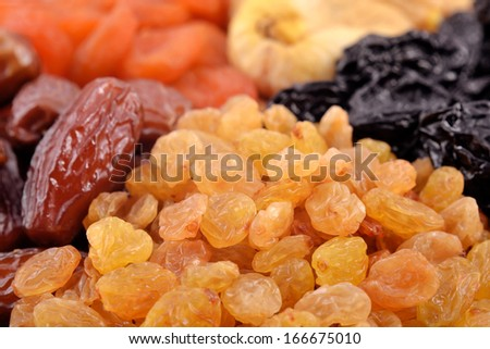 Various dried fruits  (apricots, dates, raisins, figs, prunes) close-up