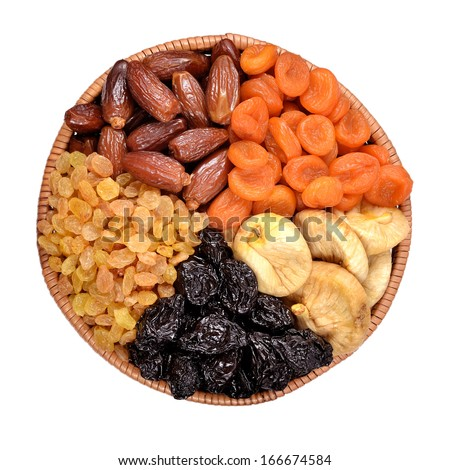 Various dried fruits in bowl on a white background