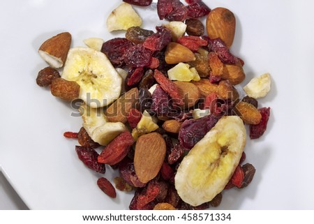 Various dried fruits on a plate for breakfast - stock photo