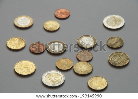 Various Euro coins on a gray background - stock photo