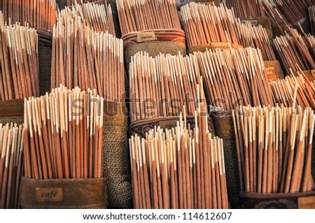 Various flavors of incense for sale.