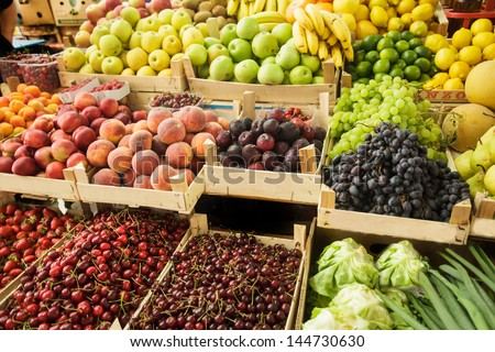 Various fresh fruits in boxes on the market - stock photo