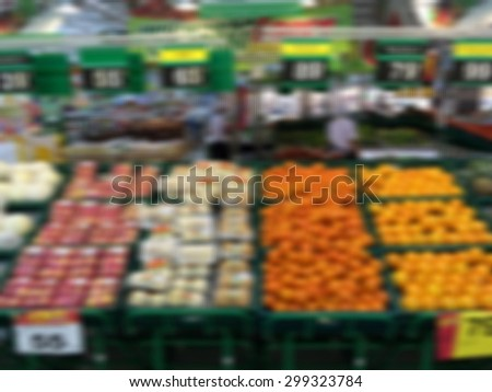 Various fresh fruits on food market stall process in blurred - stock photo