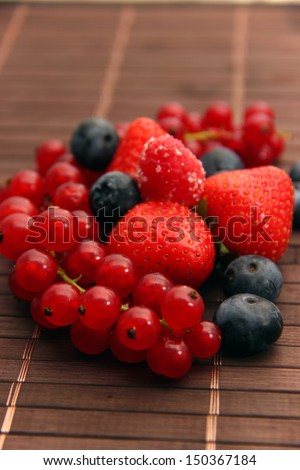 Various fresh fruits/Strawberries, blueberries and currants - stock photo