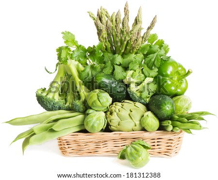 Various fresh green vegetables in basket isolated on white  - stock photo