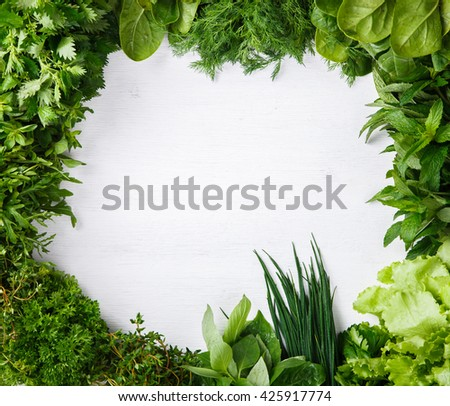 Various fresh herbs on a white background.vegetarian and healthily cooking concept.Copy space.selective focus.