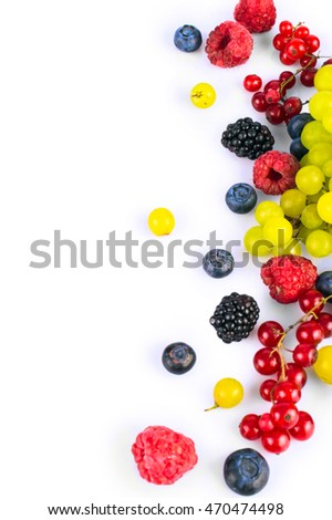 Various fresh summer fruits and berries isolated on a white background. Top view.