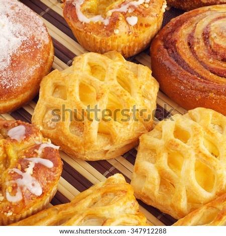various fresh sweet homemade buns on table - stock photo