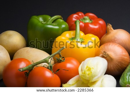 Various fresh vegetables on a dark background