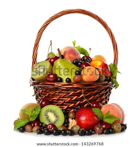 Various fruit in a brown basket isolated on white background - stock photo