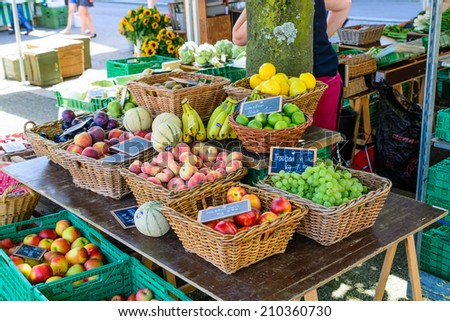 Various fruits for sale in a typical market stall in Switzerland - stock photo