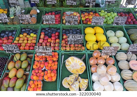 Various Fruits in Crates at Farmers Market - stock photo
