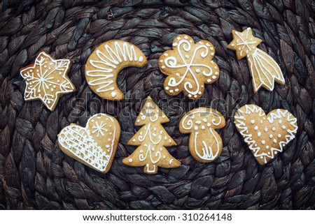 Various gingerbread cookies on the dark background. Christmas theme.