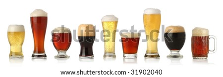 Various glasses of different beers, isolated on white - stock photo